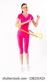 Young attractive woman with a hula hoop