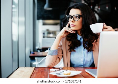 Young attractive woman looking away thoughtfully