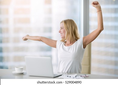 Young attractive woman at modern office desk, with laptop, stretching, getting a little exercise during the day, office workout, completing difficult task time for lunch. Business concept illustration
