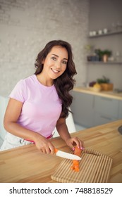 Young attractive woman on kitchen. Vegetarian Life.
