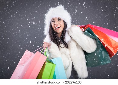 young attractive woman over snowy Christmas background