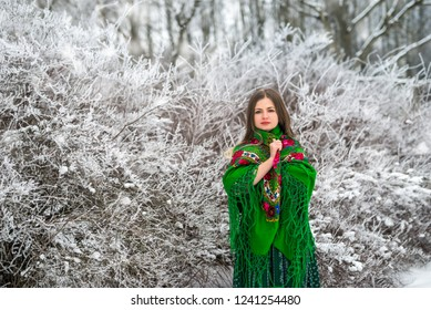 Young and attractive woman posing with green shawl