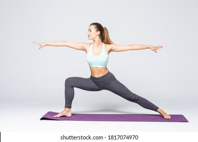 Young attractive woman practicing fitness, standing in lunge exercise, yoga pose, working out wearing sportswear, on white background