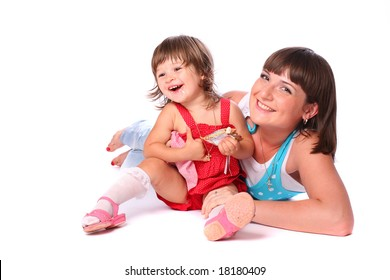 A young attractive woman and a pretty little girl laughing and having fun together