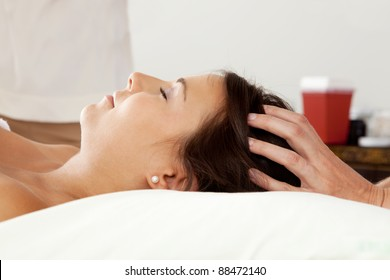 Young attractive woman receiving head massage