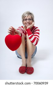 Young attractive woman with red heart on white background