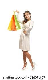 Young attractive woman with the shopping bags isolated on white