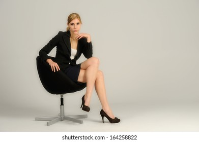 Young attractive woman sitting in a chair