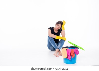 Young attractive woman tired of cleaning and housework isolated on white background
