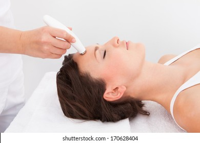 Young Attractive Woman Undergoes Microdermabrasion Therapy In Spa