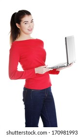 Young attractive woman working on her laptop computer