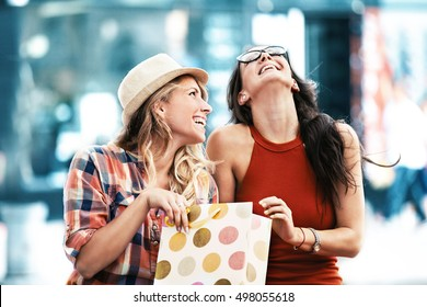 Young and attractive women enjoying shopping.