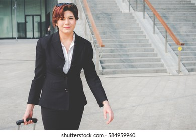 young authentic business woman in the financial district for business trip