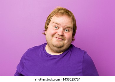 Young authentic redhead fat man showing a welcome expression.