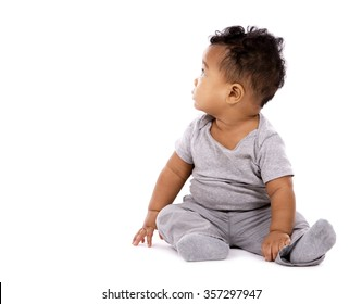 young baby boy wearing casual outfit on white background