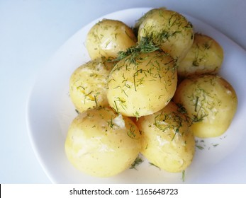 young baked potatoes with dill