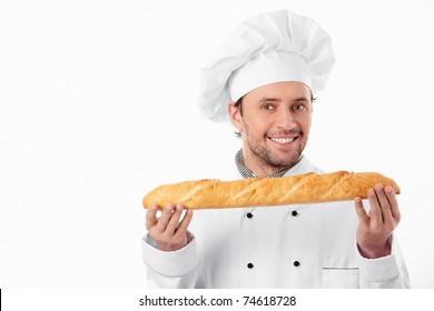 A young baker holds a loaf on a white background