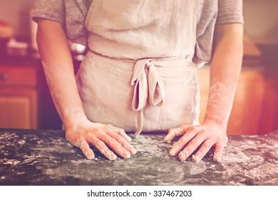 Young baker preparing artisan sourdough bread.