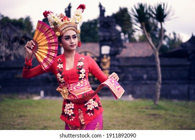A young Bali female dancer is performing the Ramayana dance in a temple of Bali, in Indonesia.