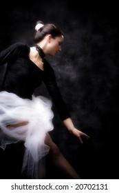 young ballerina practicing, studio shot