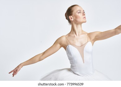 a young ballerina in the theater dancing swan lake, ballet