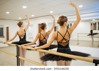 Young ballerinas, students rehearsal at the barre