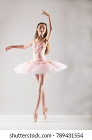 Young ballet dancer wearing pink tutu in dance studio