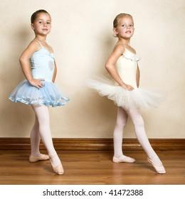 Young ballet dancers in a studio with wooden floors