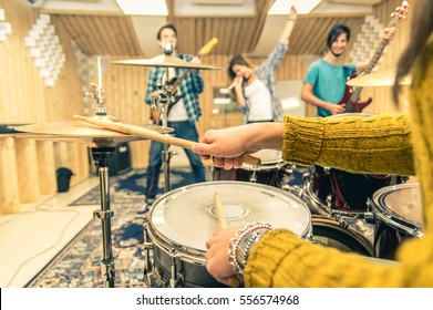 Young band music recording a song at the studio. Close up of a drummer holding chopsticks