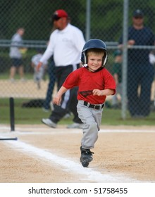 Young baseball player running and smiling during game