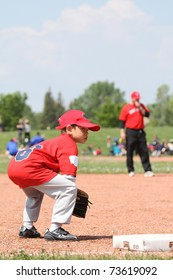 Young baseball player watching over third base