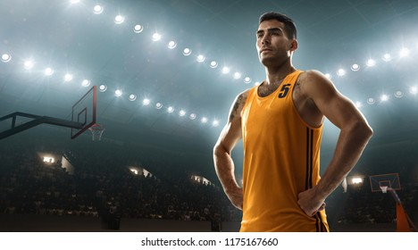 Young basketbal player on professional court