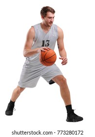 Young basketball player in gray uniform, numbered thirteen, standing with ball, isolated on white background.
