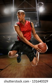 Young Basketball player jumping inside a court