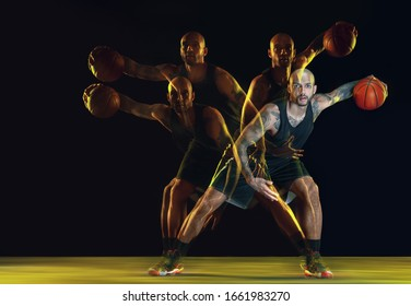 Young basketball player of team in sportwear training, practicing in action, motion isolated on dark background in neon, strobe light. Concept of sport, movement, energy and dynamic, healthy lifestyle