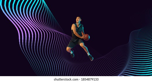 Young basketball player of team wearing sportwear training, practicing in action, motion in jump, flight on dark waved background. Concept of sport, energy. Neoned modern artwork, cover, flyer
