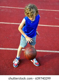 Young basketball player training with a ball outdoors