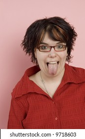 young beaitful woman sticking out tongue