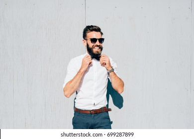 young bearded businessman outdoor posing looking away - ambition, business attire, attitude concept