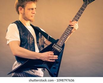 Young girl plays guitar naked