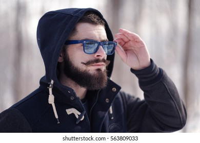 young bearded man frowning face expresses strength and determination