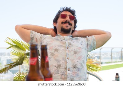 young bearded man having a beer on holydays