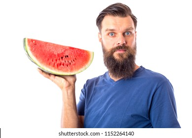 Young bearded man holding a green red watermelon slice isolated on white