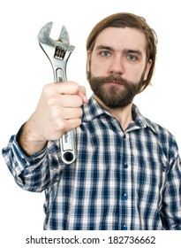 the young bearded man a holding wrench in hand