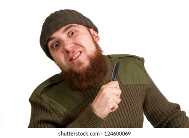 A young bearded man with a knife on a white background