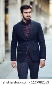 Young Bearded Man Model Of Fashion Smiling In Urban Background Wearing British Elegant Suit Guy With Beard And Modern Hairstyle The Street