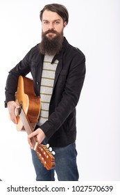 Young bearded man playing an acoustic guitar isolated over white background