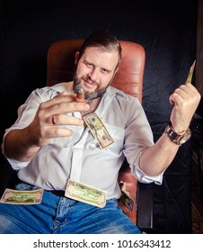 Young bearded man smoking a cigar. Flying dollars everywhere.