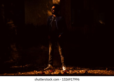 Young bearded man standing around a place in the afternoon