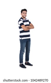 A young bearded man standing with a crossed arms in a casual outfit, isolated on a white background.